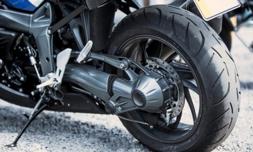 motorcycle-luxury-items-close-up-headlights-shock-absorber-wheel-wing-toning_155003-2078