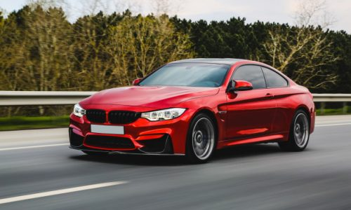 red-luxury-sedan-road_114579-5079
