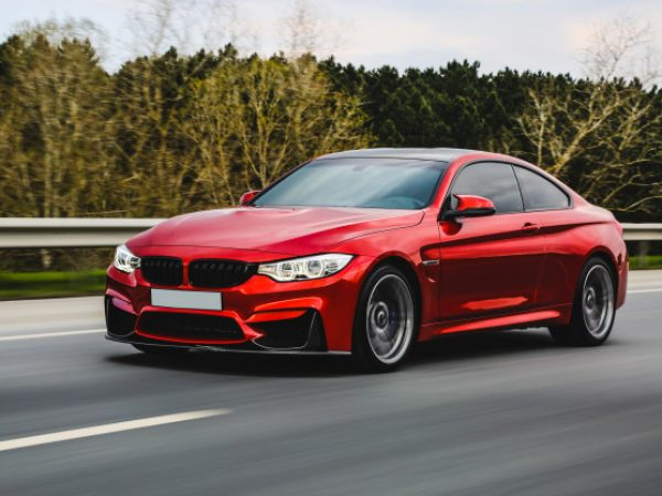 red-luxury-sedan-road_114579-5079
