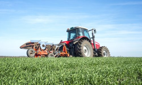 tractor-cultivating-field_342744-566